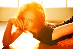 Backlight portrait of beautiful redhead woman